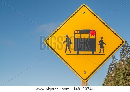 Warning sign! Slow down drive with extra caution watch for children and for a school bus with flashing red lights.