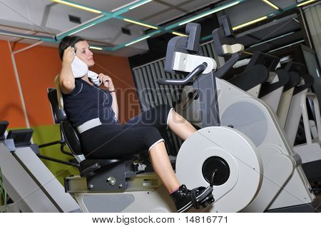 Young woman working out in fitness