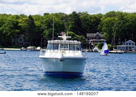 HARBOR POINT, MICHIGAN / UNITED STATES - AUGUST 1, 2016: A boat moves across Little Traverse Bay in front of Harbor Point.