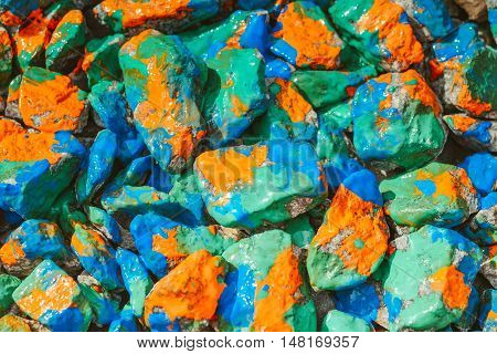 abstract background stones rubble closeup painted color ink