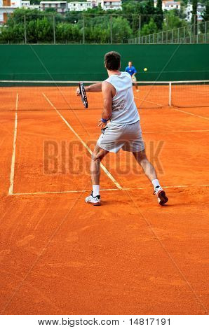 One Man play tennis on outdoor court