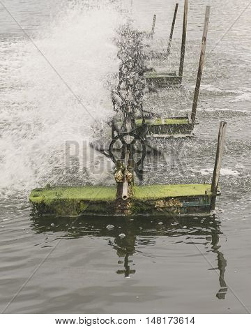 Water aeration turbine in farming aquatic. Shrimp and fish hatchery business in Thailand. poster