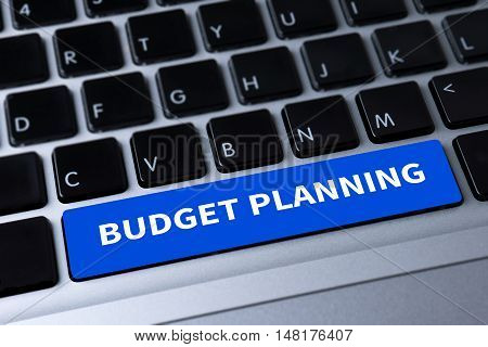 BUDGET PLANNING a message on keyboard businessman working