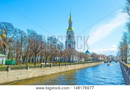 ST PETERSBURG RUSSIA - APRIL 25 2015: The bell tower of Maritime Cathedral of St Nicholas (Sailors' Cathedral) rises on the bank of Krukov Canal on April 25 in St Petersburg.