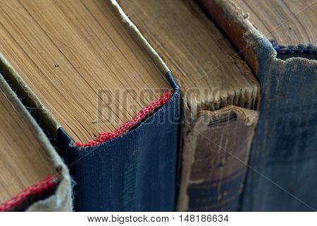 Different vintage antiquarian tattered books close up
