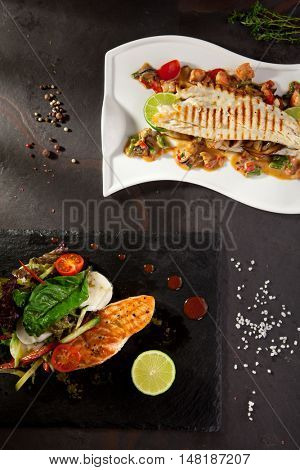 Grilled Salmon and Sea Bass with Vegetables, Spicy and Lime
