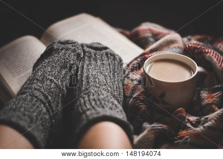 Cozy evening with a cup of coffee and interesting book