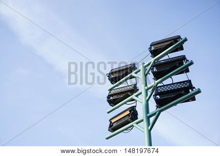 giant outdoor lamppost with blue sky background