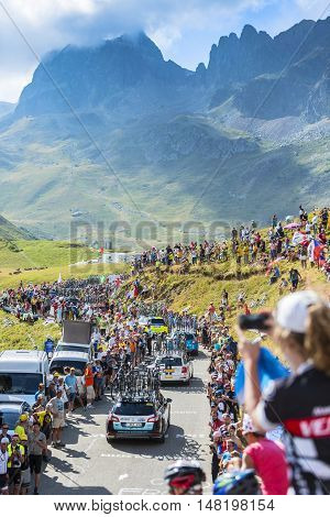 Col du Glandon France - 23 July 2015: Row of technical cars driving on the road to Col du Glandon in Alps during the stage 18 of Le Tour de France 2015.