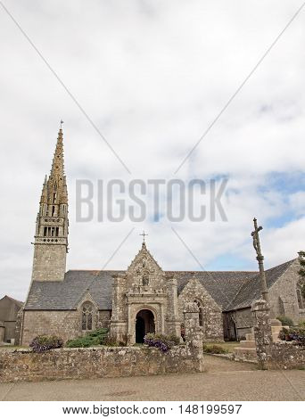 Finistere, Brittany, Beuzec church Breton church, church britain, britain architecture, Beuzec, Beuzec church, religion, tradition, catholic, religious, steeple, Christ, Christ on the cross, calvary
