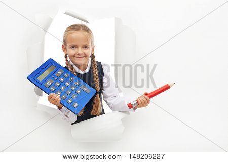 Young student holding calculator and large pencil - with copy space