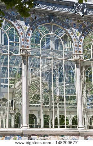 Detail of the windows of Crystal Palace (Palacio de Cristal in Spanish) in Retiro Park Madrid. Spain. It is a glass pavilion inspired by The Crystal Palace in London. It is considered one of the best examples of architecture in iron and glass in Spain.