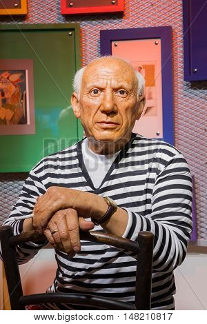 BANGKOK THAILAND - DECEMBER 19: Wax figure of the famous Pablo Picasso from Madame Tussauds on December 19 2015 in Bangkok Thailand