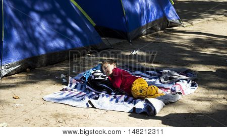 SERBIA BELGRADE - September 14 2015: Park at the station migrants from Syria have turned into a small city. Some have even set up tents and in which they reside while most sleep under the open sky.