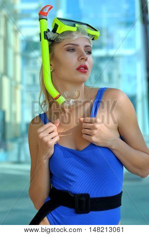 Girl Holds Strapless Of A Swimsuit.