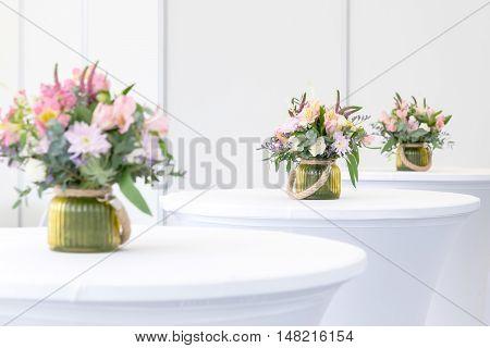 Beautiful Flower Arrangement On White Festive Tables