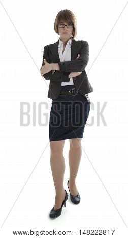 Young businesswoman standing with arms crossed on white