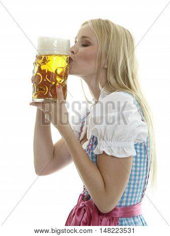 Woman in Oktoberfest Dirndl kissing a Beer Mug