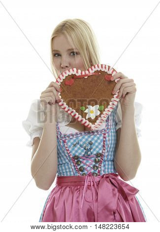 Woman with an empty Oktoberfest Gingerbread heart with copy space