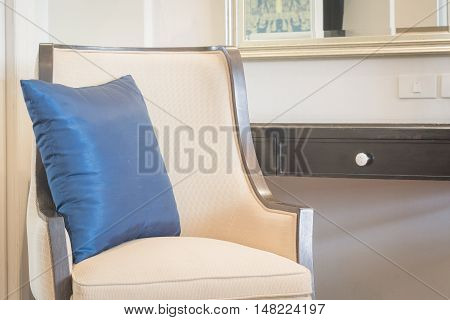 Silk backrest pillow and luxury chair in bedroom living space