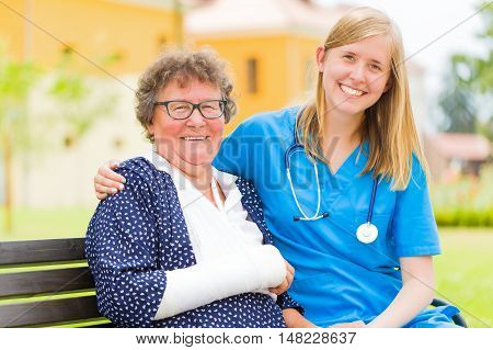 Happy Elderly Patient And Doctor