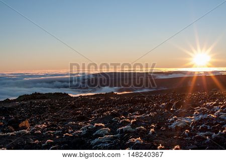 Dawn above the clouds, Russia  Alluayv mountain. More than 1000 meters above the sea level near pass of geologists.