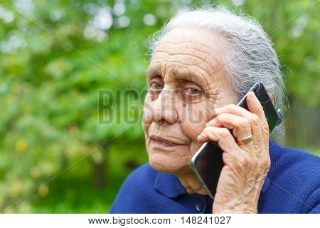 Portrait of an elderly woman while talking on cell phone