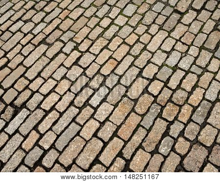 Old English cobblestone road close up detail.