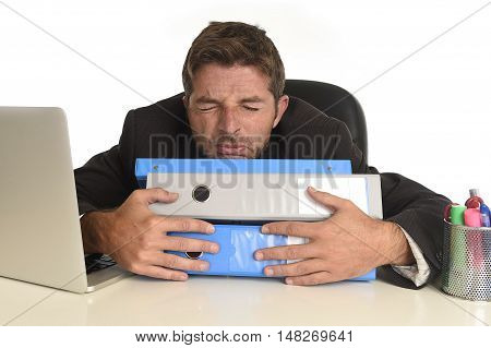 tired and frustrated businessman desperate face expression suffering stress at office computer desk holding paperwork folders overwhelmed isolated on white background