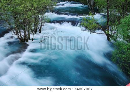 beautiful nature scene with river and waterfall at spring seasson
