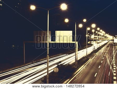 Highway at night with flares and lights