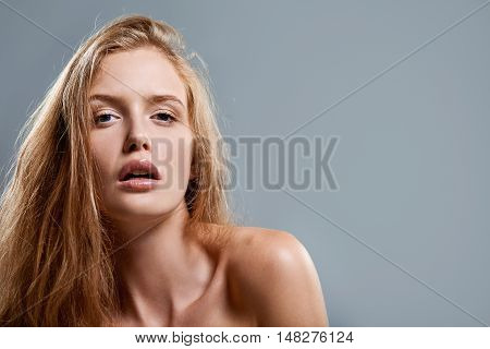 Closeup of sensual woman looking at camera with expression of temptation