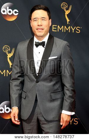 LOS ANGELES - SEP 18:  Randall Park at the 2016 Primetime Emmy Awards - Arrivals at the Microsoft Theater on September 18, 2016 in Los Angeles, CA