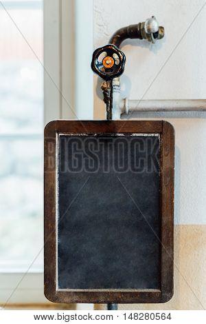 Vintage old slate chalk board hanging on wooden background