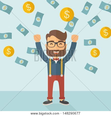 A young hipster Caucasian businessman happy under falling raining money shower a coin and bill dollar money. Winner, happy concept. A contemporary style with pastel palette soft blue tinted background