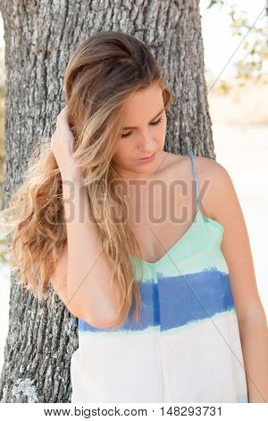 Beautiful woman on a sunny day with the wind blowing her hair