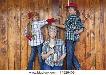 Painting the tool shed - family working together