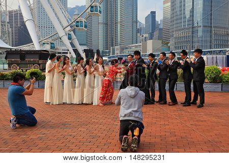 HONG KONG, DECEMBER 11, 2014: Hong Kong Special Administrative Region. The modern city on the ocean coast. Youth wedding photographed in a public park near the ferris wheel