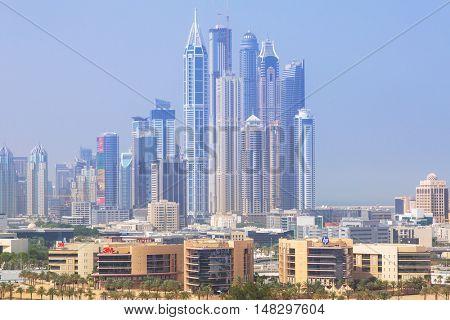 DUBAI, UAE - 1 APRIL 2014: Skyscrapers of Dubai Marina in sunny day, UAE. Dubai Marina is a district in Dubai with artificial canal city who accommodates more than 120,000 people.