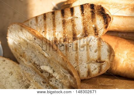 slices of toasted bread on the gridiron