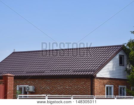 The roof of corrugated sheet. Roofing of metal profile wavy shape. poster