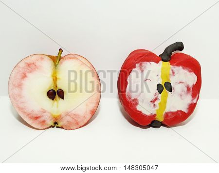 GMO idea. Comparison of two apples - Real and Fake.