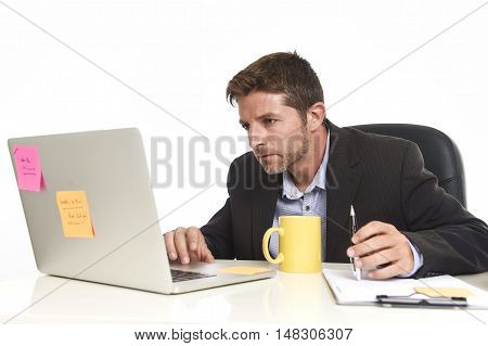young attractive businessman working concentrated and confident at office reading file drinking coffee sitting on laptop computer desk in success business concept isolated in white background