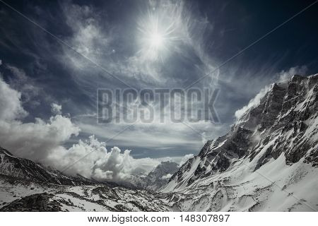 Snowy mountains in evening cloudy sky. Altay