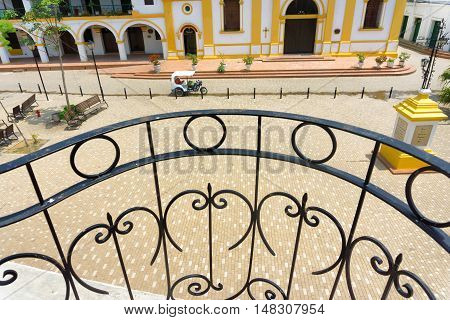 Iron railing overlooking a colonial plaza in Mompox Colombia