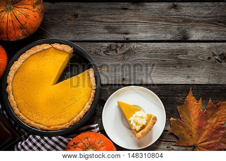 Pumpkin Pie For Thanksgiving On Old Rustic Background.
