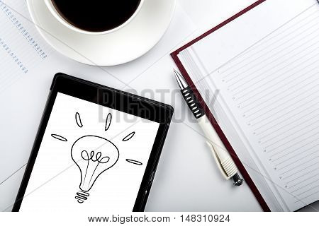 ideas icon on the computer tablet and coffee cup