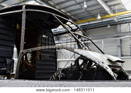 Detail with helicopter fuselage on the repair line in a factory