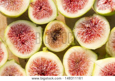 Rotten and fresh figs on a wooden board