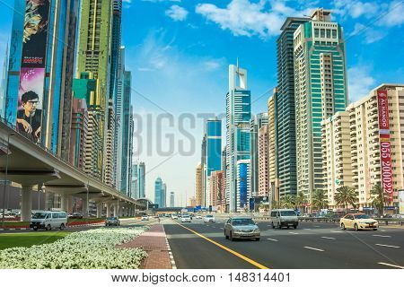 Dubai, United Arab Emirates - May 1, 2013: traffic on Sheikh Zayed Road which runs through Dubai and is home to the most modern skyscrapers located in the Dubai Downtown district. Dubai skyline.